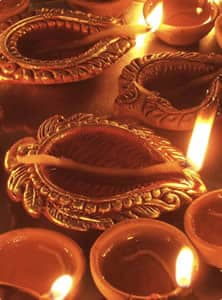 Diya, earthen lamps filled with oil, are lit for Diwali.